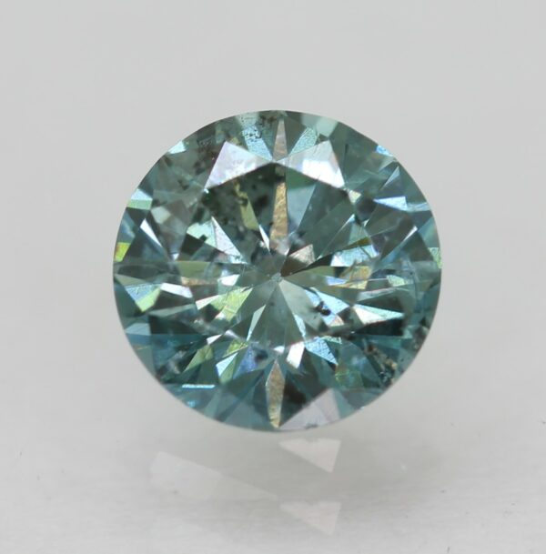 0.28 Ct Fancy Vivid Greenish Blue Round Brilliant Enhanced Natural Diamond 4.08m #26
