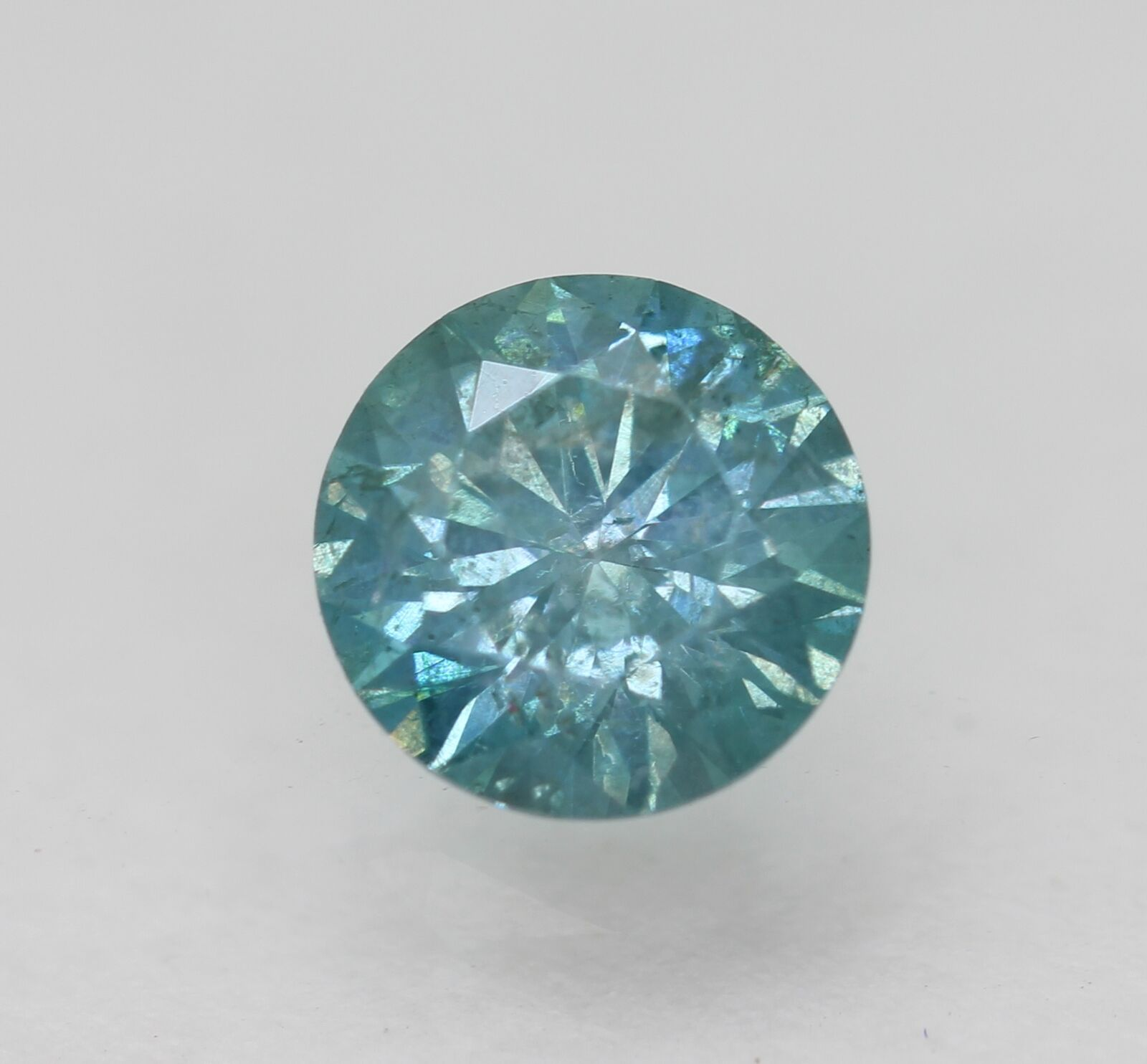 Certified 0.64 Carat Intense Blue SI1 Round Brilliant Natural Diamond 5.54mm