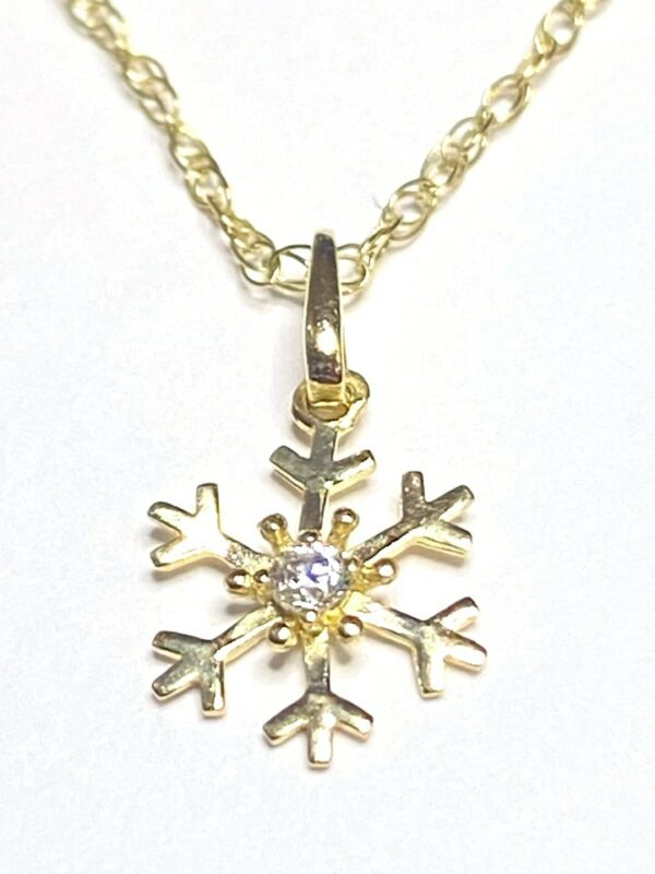 9k Yellow Gold Snowflake Pendant set with Cubic Zirconia and Chain