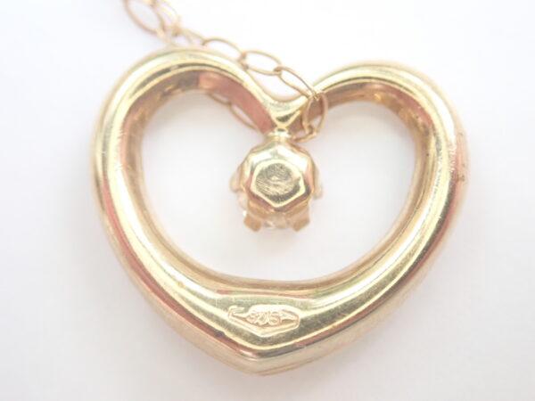 Floating Heart Cubic Zirconia Pendant 375 9k – 16 inch 9k gold Chain